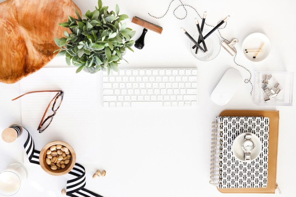 tips for new bloggers flatlay with keyboard notebooks glasses coffee plant